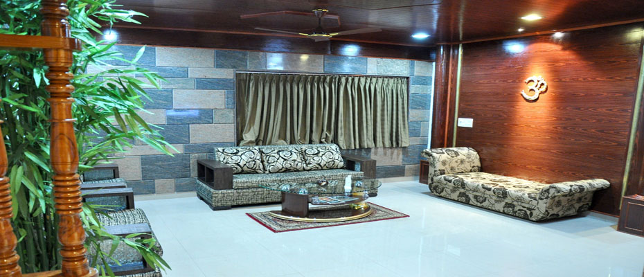 Hotel Sharada International Sai Kutir Suite Living Room
